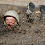 Soldier falling in mud